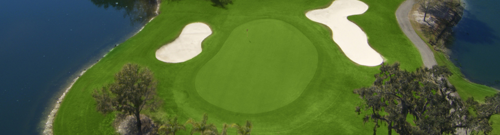 An aerial view of one of the holes on the course at Cypress Run, sandwiched by two sandtraps